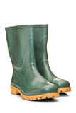 A studio shot of a green rubber boots Stock Photos
