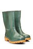 A studio shot of a green rubber boots Stock Photos
