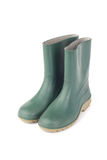 Studio shot of a green rubber boots  on white background Stock Photos