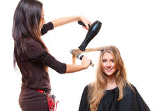 Studio shot of hairdresser with hairdryer Stock Photos