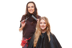 Studio shot of hairdresser and young woman Royalty Free Stock Photo
