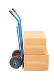 Studio shot of a hand truck with carton boxes. Isolated on white background Stock Image