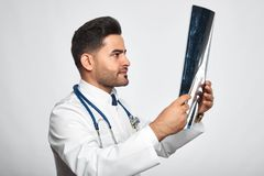 Male doctor posing at studio Royalty Free Stock Photos