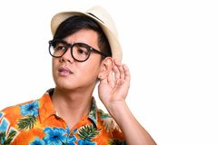 Close up of handsome Asian man listening. Studio shot of handsome Filipino tourist man against white background stock photos