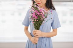 Studio shot of happiness woman receiving pretty flowers Stock Photography