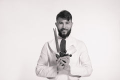 Studio shot of a happy bearded young chef holding sharp knives o royalty free stock photography