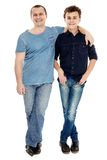 Studio shot of happy father and son. Full length studio shot of happy father and son, isolated over white background Stock Photo