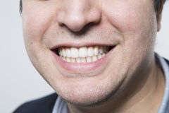 Studio shot of happy person and white teeth. Dark-haired european businessman shows us his perfect grin while in front of a gradient background stock images