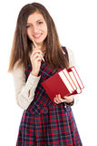 Studio shot of happy student  with a pile of books holding a pen Royalty Free Stock Image