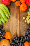 Studio Shot of Healthy eating ,different fruits on old wooden ta Royalty Free Stock Images