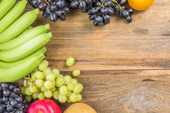 Studio Shot of Healthy eating ,different fruits on old wooden ta Stock Photos