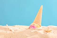 Studio shot of an ice cream splashed on sand Stock Image