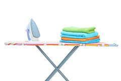 Studio shot of iron and towels on ironing board Royalty Free Stock Image