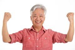 Studio Shot Of Jubilant Chinese Senior Man Stock Image