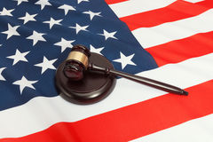 Studio shot of a judge gavel and a soundboard over USA flag Royalty Free Stock Photo