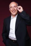 Studio shot of laughing businessman Stock Image