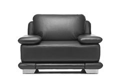 A studio shot of a leather black armchair Royalty Free Stock Image