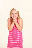 Studio shot of little blonde girl Stock Image