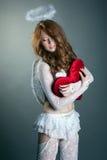 Studio shot of lovely girl posing in angel costume Stock Photography