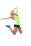 Studio shot of lovely long-haired blonde jumping Royalty Free Stock Photo