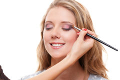Studio shot of lovely young woman having make up Stock Image