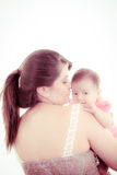Studio shot of loving mother holding baby Royalty Free Stock Photos