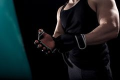 Studio shot of male boxer. Studio shot of male boxer punching a boxing bag stock photography