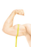 Studio shot of a male muscles with measuring tape. Isolated on white background Royalty Free Stock Photo