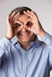Studio Shot Of Man Making Spectacle Shape With His Hands Stock Images