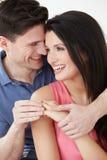 Studio Shot Of Man Putting Ring On Woman's Finger Royalty Free Stock Image