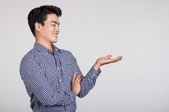 Studio shot of a man`s hand pointing at something Royalty Free Stock Photos