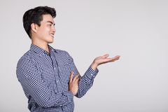 Studio shot of a man`s hand pointing at something Stock Photo