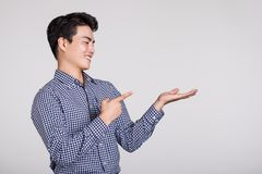 Studio shot of a man`s hand pointing at something Stock Photos