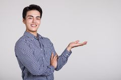Studio shot of a man`s hand pointing at something Royalty Free Stock Photography