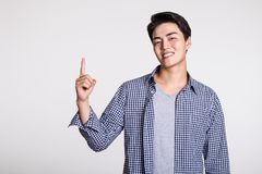 Studio shot of a man`s hand pointing at something. Shot Stock Photography
