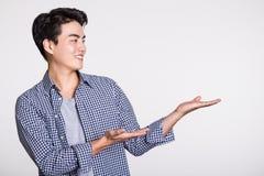 Studio shot of a man`s hand pointing at something. Shot Royalty Free Stock Image