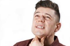 Studio Shot Of Man Suffering With Sore Throat. Studio Shot Of Man Suffering From Sore Throat Stock Photos
