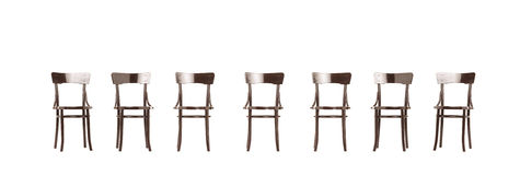 Studio shot of many wooden old styled chairs Stock Photos