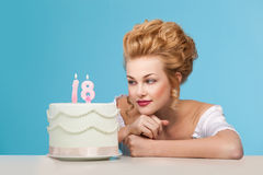 Studio shot in the Marie Antoinette style with cake. Beautiful woman dressed up like  Marie Antoinette posing with cake Royalty Free Stock Photography