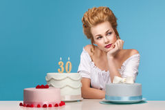Studio shot in the Marie Antoinette style with cake. Beautiful woman dressed up like  Marie Antoinette posing with cakes Royalty Free Stock Photo