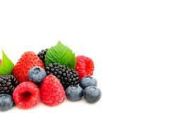 Studio shot mixed berries isolated on white. Close-up arrangement with mixed, assorted berries including blackberries, strawberry, blueberry and raspberries and Royalty Free Stock Photography