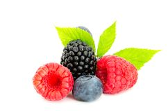 Studio shot mixed berries isolated on white. Close-up arrangement with mixed, assorted berries including blackberries, strawberry, blueberry and raspberries and Royalty Free Stock Image