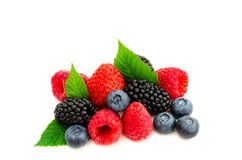 Studio shot mixed berries isolated on white. Close-up arrangement with mixed, assorted berries including blackberries, strawberry, blueberry and raspberries and Royalty Free Stock Photos