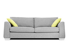 Studio shot of a modern couch with pillows. Isolated on white background Stock Images