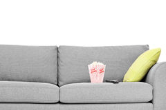 Studio shot of a modern sofa with popcorn box on it Royalty Free Stock Images