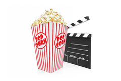 A studio shot of a movie clap and popcorn box Royalty Free Stock Images