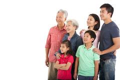 Studio Shot Of Multi-Generation Chinese Family Royalty Free Stock Image