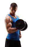 Studio shot of muscular young man lifting barbell. Studio shot of a muscular young man lifting a barbell isolated on white background Stock Photo