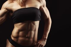Studio shot of muscular young woman Royalty Free Stock Photo