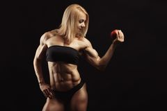 Studio shot of muscular young woman Stock Image